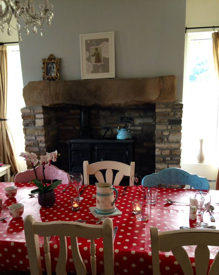 house tour table by fire in kit